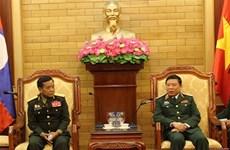 越南和老挝军队就安全保护工作分享经验