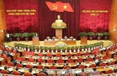 越共第十一届中央委员会第十四次全体会议在河内隆重开幕
