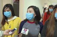 从中国武汉回国的30名越南人出院回家