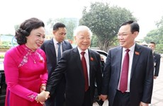 组图:越共中央总书记、国家主席阮富仲出席越共河内市第十七次代表大会开幕式