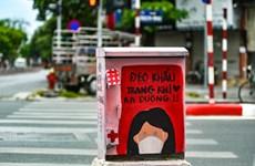 组图:河内电箱化身新冠疫情宣传海报