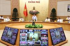 越南政府总理范明政主持召开全国新冠肺炎疫情防控工作视频会议