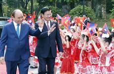 阮春福举行仪式欢迎老挝政府总理通伦·西苏里访越(组图)
