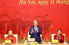 组图:阮春福总理表彰奖励荣获第30届东运会冠军的越南男女足球队