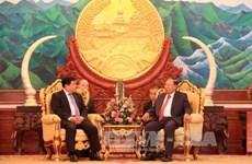 老挝人民革命党中央总书记、国家主席会见越南计划投资部代表团
