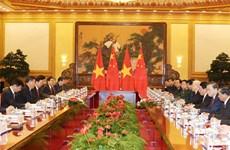 越共中央总书记阮富仲与中共中央总书记习近平举行会谈
