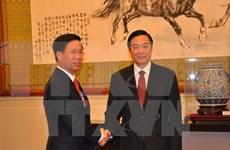 越共中央宣教部部长武文赏会见中共中央宣传部部长刘奇葆