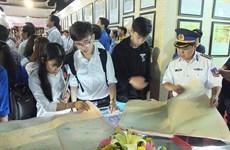 """""""黄沙和长沙归属越南—历史证据和法律依据""""资料图片展在同塔省举行"""