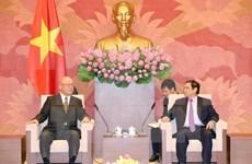 越共中央组织部部长范明正会见日越友好议员联盟特别顾问