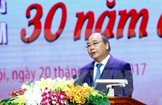 """政府总理阮春福出席""""光荣越南-30年革新的烙印""""活动"""