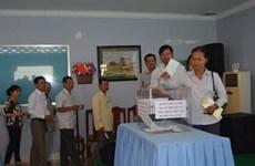越裔柬埔寨人总会为国内灾民开展赈灾捐款活动