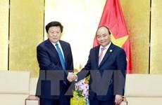 政府总理阮春福会见出席2017年APEC工商领导人峰会的大型企业领导