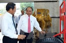 越南政府总理阮春福视察越南橡胶工业集团