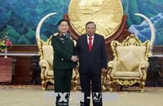 老挝人民革命党中央总书记、国家主席本扬会见越南高级军事代表团