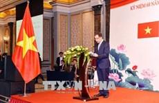 越中建交68周年庆祝招待会在北京举行