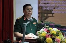 越南人民军总政治局副主任阮仲义上将拜会老挝人民军总政治局主任维莱•拉坎冯中将