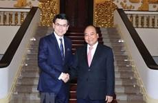 阮春福会见中国香港政府商务及经济发展局局长邱腾华