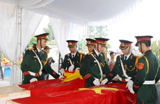 深切哀悼在老挝牺牲的越南志愿军烈士