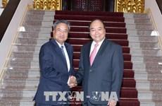 越南政府总理阮春福会见老挝人民革命党中央组织部部长占西•普西坎