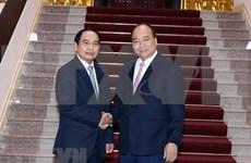 越南政府总理阮春福会见老挝监察总署总监察长本通•吉马尼