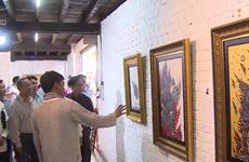 """越老泰""""连接湄公河两岸""""美术展在老挝举行"""