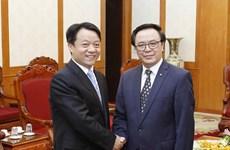越共中央对外部部长黄平君会见中国共青团代表团