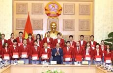 阮春福总理亲切会见参加第18届亚运会的越南体育代表团