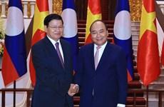 WEF ASEAN 2018: 政府总理阮春福会见老挝总理通伦·西苏里
