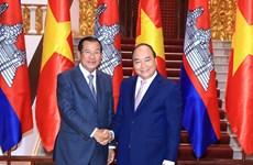 WEF ASEAN 2018:政府总理阮春福会见柬埔寨首相洪森和湄公河委员会领导