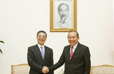 越南政府副总理张和平会见中国最高人民法院院长周强