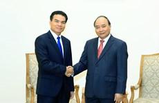 越南政府总理阮春福会见老挝总理府部长兼办公厅主任佩·蓬皮帕
