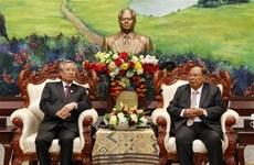 老挝人民革命党中央委员会总书记、老挝国家主席会见越共代表团