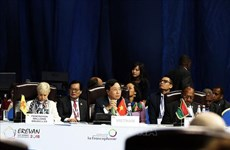 越南政府副总理兼外长范平明在第十七届法语国家组织峰会上发言