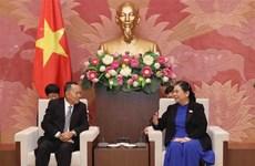 国会副主席丛氏放会见老挝巴特寮通讯社代表团