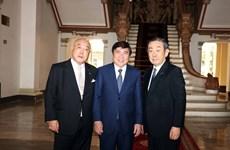 胡志明市领导会见日本政府政治顾问饭岛勋