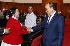 越南政府总理阮春福会见岘港市海州郡革命有功者代表团
