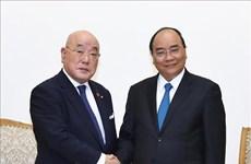 政府总理阮春福会见日本首相特别顾问饭岛勋