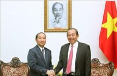 政府常务副总理张和平会见老挝最高人民法院院长坎帕•森达拉
