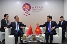 越南政府副总理兼外长范平明会见中国外长王毅