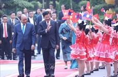 老挝媒体密集报道老挝总理通伦访越之旅