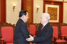 越共中央总书记、国家主席阮富仲会见柬埔寨人民党主席、政府首相洪森