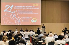 越南共产党代表团出席第21次共产党和工人党国际会议