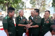 山萝省和老挝乌多姆赛省交换老兵活动经验