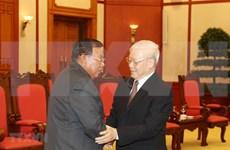 越共中央总书记、国家主席阮富仲会见老挝人民革命党总书记、国家主席本扬