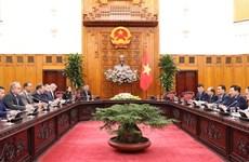 越南政府副总理范平明会见美国企业代表团