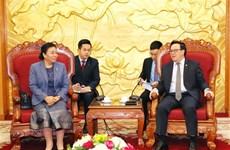 越共中央对外部部长黄平君会见老挝革命人民党中央对外部代表团