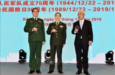 越南人民军建军75周年和全民国防日30周年纪念典礼在中国举行