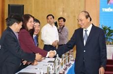 越南政府总理阮春福:促进机制体制建设 构建新经济模式