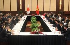 越共中央组织部长范明政会见日本自民党秘书长二阶俊博
