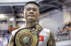 越南拳击运动员张廷煌获WBA亚洲区超中量级冠军金腰带